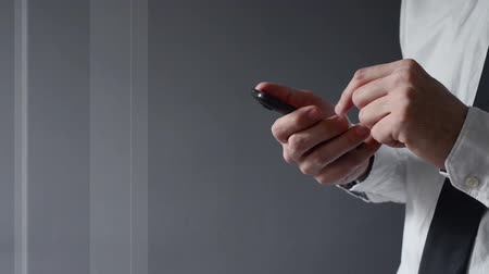 Businessman using smartphone. Hands scrolling and typing the screen of modern smart phone device. Stock Footage