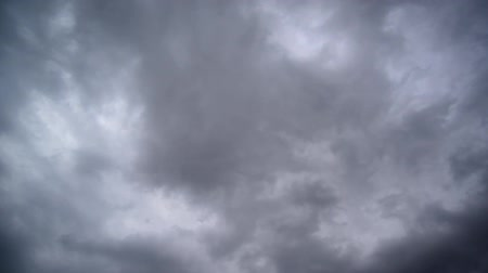 dark sky : Dramatic Sky with dark stormy white clouds, time lapse shot.