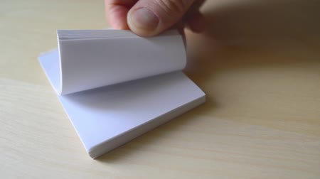 blank : Man flipping pages of small book Stock Footage