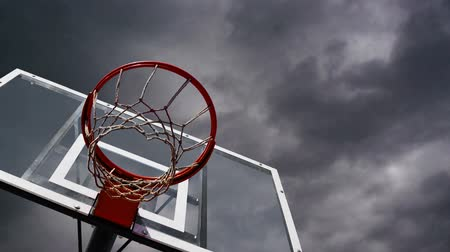 баскетбол : Basketball hoop with cage with clouds time lapse footage in background. 1920x1080, 1080p, hd footage. Стоковые видеозаписи
