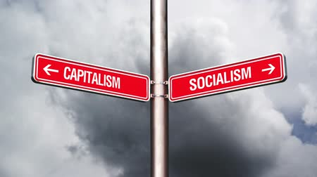rehberlik : Capitalism or Socialism, conceptual video with opposite direction guidance signs. 1920x0180, 1080p, hd footage.