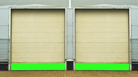 entrada da garagem : Industrial Unit with roller shutter doors. Warehouse storage doors with green screen mate background are opening. 1920x1080, 1080p, hd, high definition footage. Vídeos