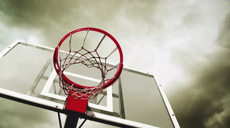 abroncs : Basketball hoop with clouds time lapse footage in background. 1920x1080, 1080p, full hd format.