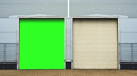 garagem : Industrial Unit with roller shutter doors. Warehouse storage doors with green screen mate background are closing. 1920x1080, 1080p, hd, high definition footage.