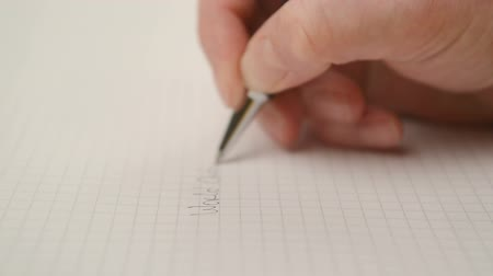 synopsis : Woman writing notes in notebook, close up steady footage with selective focus on hand. 1920x1080 full hd footage