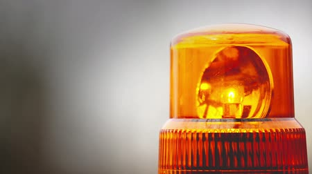 orange : Flashing revolving light on top of a police, firemen, hospital emergency support and services vehicles. 1920x1080 full hd steady footage.