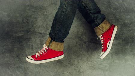 tarz : Loopable Stop Motion Animation of Young Person in Jeans and Red Sneakers Walking, 1920x1080 full hd footage.