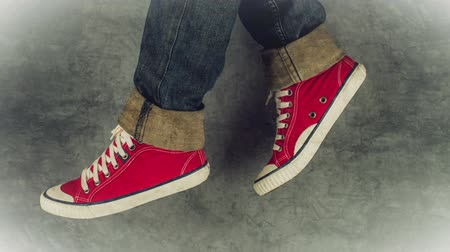 yaşam tarzı : Loopable Stop Motion Animation of Young Person in Jeans and Red Sneakers Walking, 1920x1080 full hd footage.