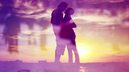 apaixonado : Silhouettes of Romantic Love Couple Meeting in Sunset, Kissing and Hugging. 1920x1080 full hd footage.