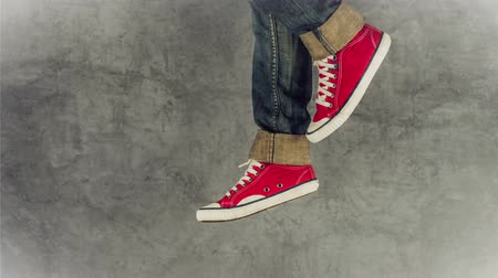életmód : Loopable Stop Motion Animation of Young Person in Jeans and Red Sneakers Running, 1920x1080 full hd footage.