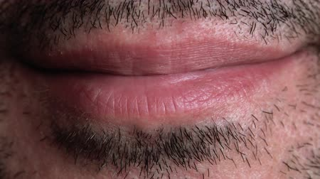 macro : Unshaven Adult Male Smiling Lips Macro Close Up Footage.