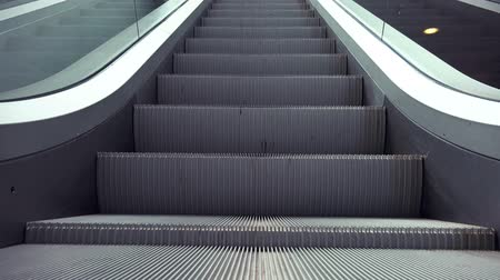 okazja : Escalators in Modern Urban Interior Moving Staircase as Easy Opportunity or Success Concept.
