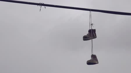travessura : Shoe Tossing, Old Sneakers Hanging on Power Line Wire, Urban Scenery