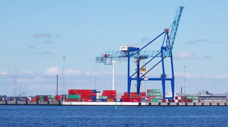 ipari : MALMO, SWEDEN - JUNE 26, 2015: Malmo Industrial Sea Port with Loading Crane and Colorful Cargo Containers on Bright Sunny Day