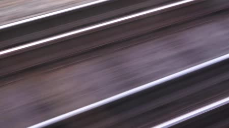 vasúti : View of the railway through train window moving fast, motion blur rails as concept of speed and traveling