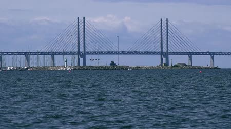 kodaň : MALMO, SWEDEN - JUNE 26, 2015: Malmo Oresund bridge, double-track railway and motorway bridge between Sweden and Denmark, with its 8 km is longest combined bridge in Europe. Dostupné videozáznamy