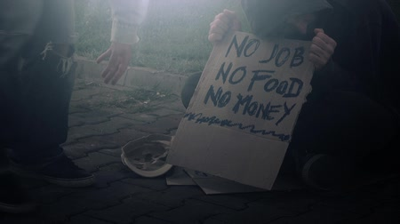 csavargó : People giving change money to homeless person begging on the street, no job, no food, no money concept, 1080p hd footage