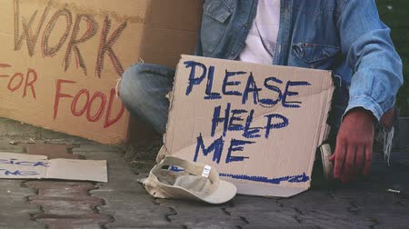 evsiz : Homeless beggar asking for help, adult man begging on the street.