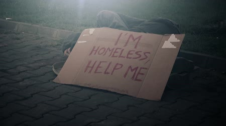 desemprego : Homeless beggar sleeping on the street, adult man begging down on pavement