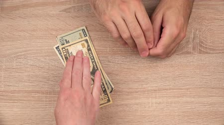 loans : Keep your hands away from my money, man counting cash payment in euro banknotes and hits female hand trying to grab the money. Stock Footage
