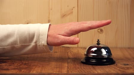 sinos : Angry female guest ringing hotel reception bell, hand pushing accommodation call bell on wooden reception front desk Vídeos