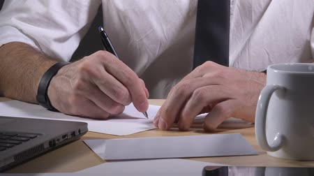 letras : Businessman writing resignation notice letter, leaving job, work desk close up. Vídeos