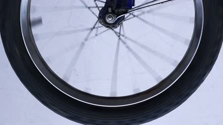 bicycle : Bicycle wheel spinning, close up footage Stock Footage