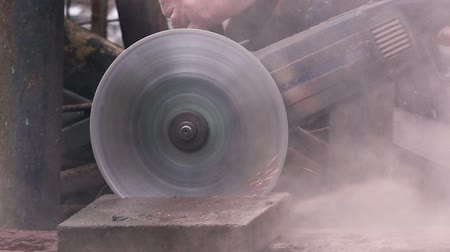 ferramenta : Worker grinding stone block with electric tool, 1080p hd footage.