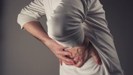 cramps : Severe back pain, man suffering from back ache having painful cramps. Stock Footage