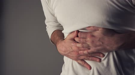 hasi : Bellyache, severe abdominal pain, man holding his belly and having painful cramps.
