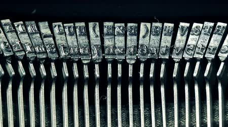 tipo : Type hammers of an old manual typewriter machine, close up, typing text on vintage typing machine.