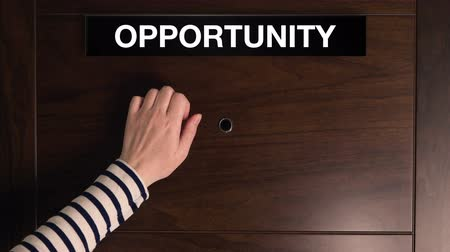 fırsat : Female hand knocking on the doors of Opportunity, woman taking a business chance concept.