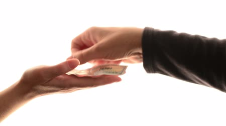 loans : Man loaning hundred dollars to woman, hands isolated over white background. Stock Footage