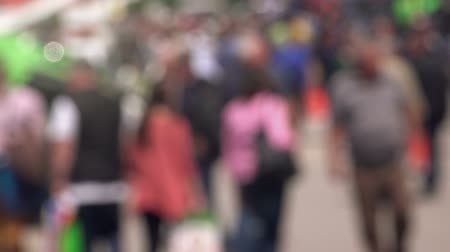 blur : Large group of people walking down the street in blur, defocussed crowd in urban environment. Stock Footage