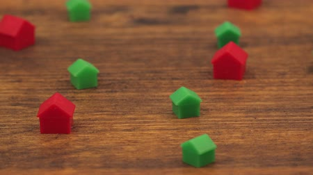 loans : Miniature plastic houses on wooden table as mortgage concept, dolly slider camera slow motion Stock Footage