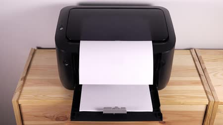 бумага : Office desktop laser printer printing single A4 letter page Стоковые видеозаписи