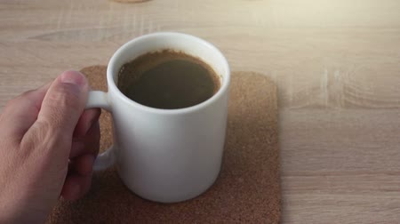 кофе : Man drinking coffee in the morning, pov shot of hand with beverage cup Стоковые видеозаписи