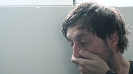 carrancudo : Troubled depressive man thinking about possible solutions for life problems, adult unshaven male in desperate situation. Stock Footage