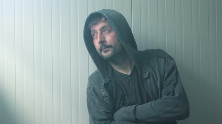 tek başına : Hopeless hooded man in desperate situation, adult male having addiction crisis.