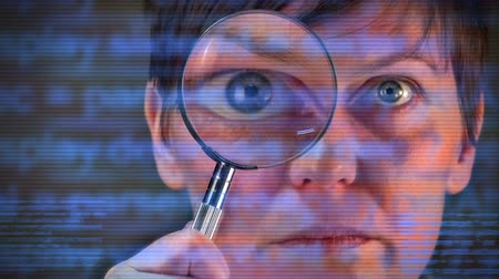szukanie : Computer code inspector, businesswoman with magnifying glass looking into the software lines and searching for viruses and malware.