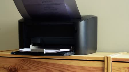 másológép : Compact small home office laser printer is printing documents on A4 paper Stock mozgókép
