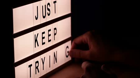 temperament : Just keep trying, motivational message on lightbox Stock Footage