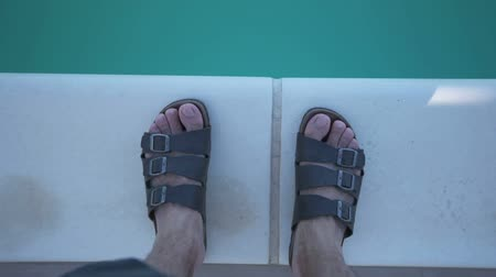 male : Bare male feet in cool blue swimming pool water Stock Footage