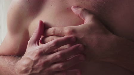 chest pain : Pain symptoms - chest ache. Closeup of man feeling bad and ill, suffering from painful chest or heart attack. Health care and medicine concepts.