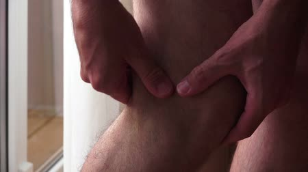arthritis : Pain symptoms - knee ache. Closeup of man feeling bad and ill, suffering from painful knee. Health care and medicine concepts.