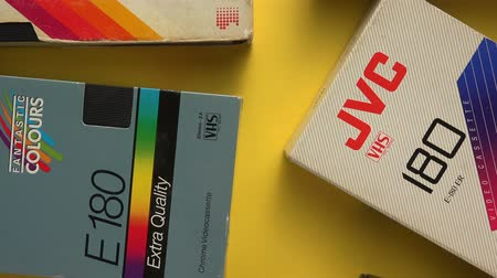 videocassette : NOVI SAD, SERBIA - NOVEMBER 6, 2017: Various VHS video cassettes. Video Home System, consumer-level analog video recording on tape cassettes standard, was released in Japan in late 1970s Stock Footage