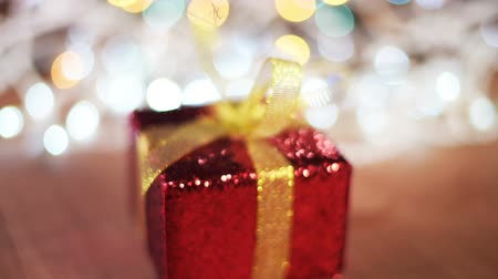 giveaway : Christmas gift box on the table, selective focus Stock Footage