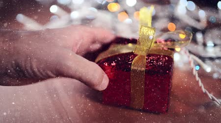 giveaway : Male hand with Christmas gift box, selective focus Stock Footage