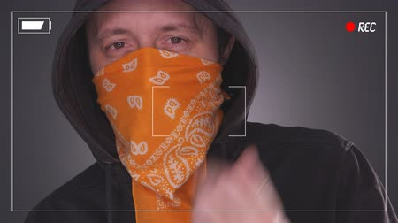 езда с недозволенной скоростью : Terrorist makes demands to video camera, terrorism and violence with hooded person and scarf over face