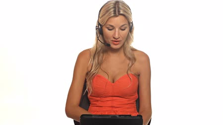 people talking : Pretty blonde woman with tablet in studio
